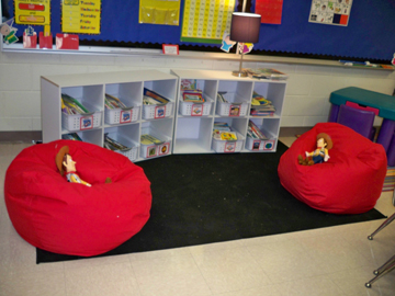 The new classroom library area with comfy bean bag chairs