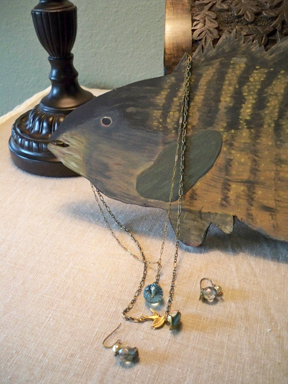 New jewelry and a wooden fish carved by my Dad