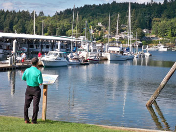 My husband, Tom, reading a sign at Gig Harbor marina