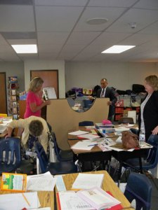 Principal Gilberto and others move small-group table to a better location