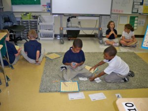All students play in pairs around the room