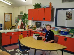 Happy teacher in new small-group area