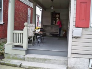 My Mom on the front porch of the house where I grew up